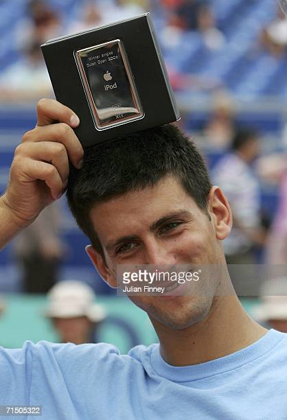 Novak Djokovic of Serbia Montenegro celebrates defeating Nicolas Massu of Chile in straight sets with his prize an ipod after the final during the...