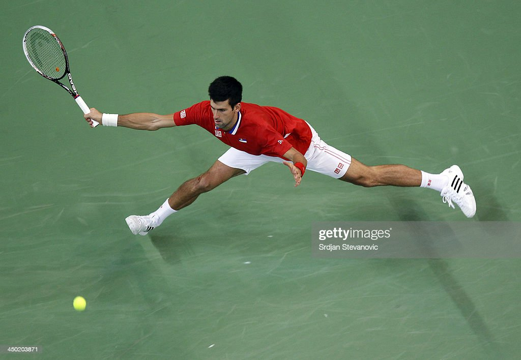 Novak Djokovic of Serbia play a forehand during the men's singles match between Novak Djokovic of Serbia and Tomas Berdych of Czech Republic on day three of the Davis Cup World Group Final between Serbia and Czech Republic at Kombank Arena on November 17, 2013 in Belgrade, Serbia.