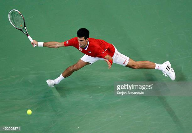 Novak Djokovic of Serbia play a forehand during the men's singles match between Novak Djokovic of Serbia and Tomas Berdych of Czech Republic on day...