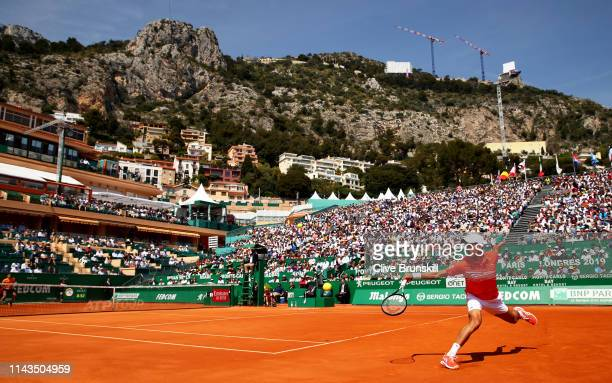 Novak Djokovic of Serbia plays a back against Taylor Fritz of the United states in their third round match during day five of the Rolex Monte-Carlo...