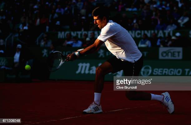 Novak Djokovic of Serbia plays a backhand against David Goffin of Belgium in their quarter final round match on day six of the Monte Carlo Rolex...