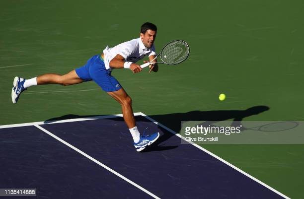 Novak Djokovic of Serbia plays a backhand against Philipp Kohlschreiber of Germany during their men's singles third round match on day nine of the...