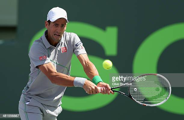 Novak Djokovic of Serbia plays a backhand against Rafael Nadal of Spain during their final match during the final of the Sony Open at Crandon Park...