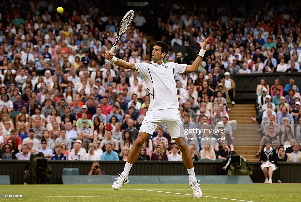 Novak Djokovic of Serbia plays a backhand during his Gentlemen's Singles second round match against Bobby Reynolds of the United States of America on day four of the Wimbledon Lawn Tennis Championships at the All England Lawn Tennis and Croquet Club on June 27, 2013 in London, England.