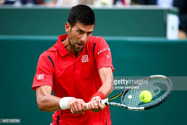Novak Djokovic of Serbia plays a backhand during his match against David Goffin of Belgium during day two of The Boodles Tennis Event at Stoke Park...