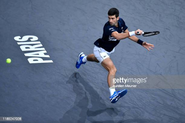 Novak Djokovic of Serbia plays a backhand during his Men's Singles Final match against Denis Shapovalov of Canada on day 7 of the Rolex Paris...