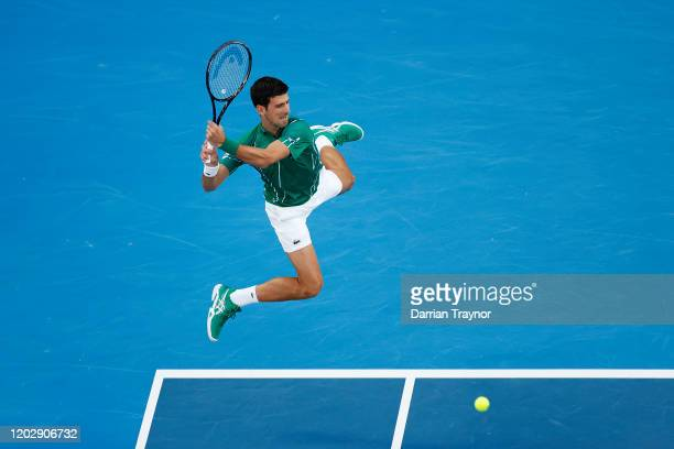 Novak Djokovic of Serbia plays a backhand during his Men's Singles Semifinal match against Roger Federer of Switzerland on day eleven of the 2020...