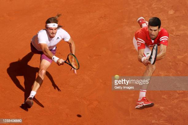 Novak Djokovic of Serbia plays a backhand during his Men's Singles Semi Final match against Rafael Nadal of Spain on day Thirteen of the 2021 French...