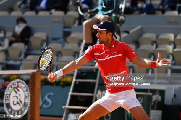 Novak Djokovic of Serbia plays a backhand during his Men's Singles second round match against Ricardas Berankis of Lithuania on day five of the 2020...