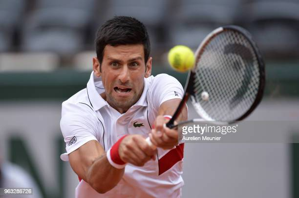 Novak Djokovic of Serbia plays a backhand during his mens singles first round match against Rogerio Dutra Silva of Brazil during day 2 of the 2018...