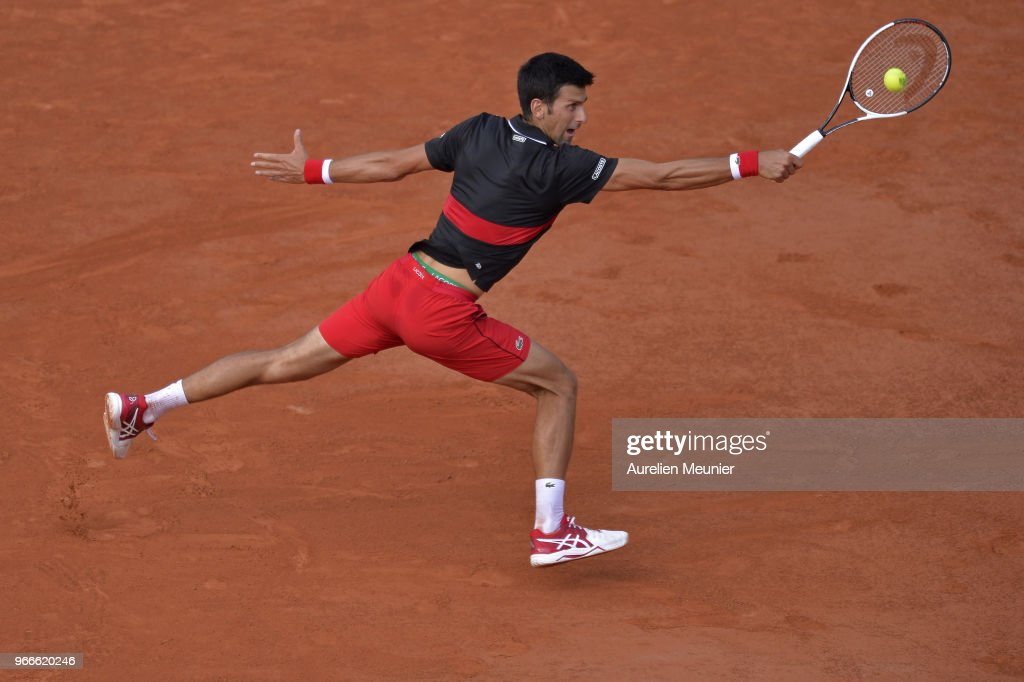 Novak Djokovic of Serbia plays a backhand during his mens singles fourth round match against Fernando Verdasco of Spain during day 8 of the 2018 French Open at Roland Garros on June 3, 2018 in Paris, France.