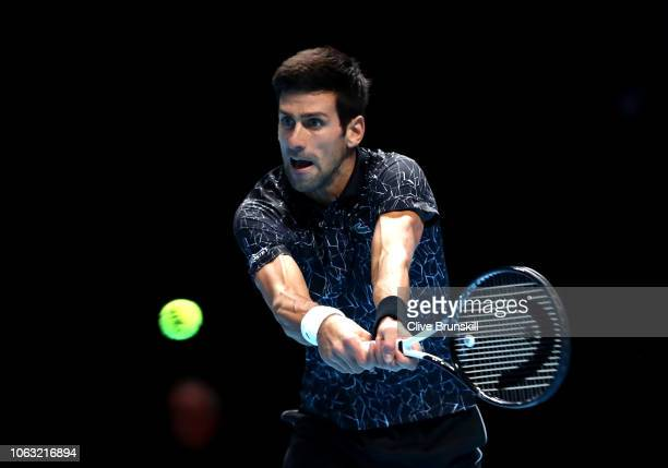 Novak Djokovic of Serbia plays a backhand during his singles final against Alexander Zverev of Germany during Day Eight of the Nitto ATP Finals at...