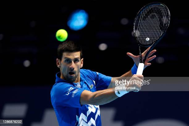 Novak Djokovic of Serbia plays a backhand during his singles semi final match against Dominic Thiem of Austria during day seven of the Nitto ATP...