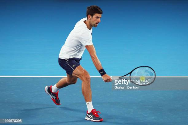 Novak Djokovic of Serbia plays a backhand during practice ahead of the 2020 Australian Open at Melbourne Park on January 15, 2020 in Melbourne,...