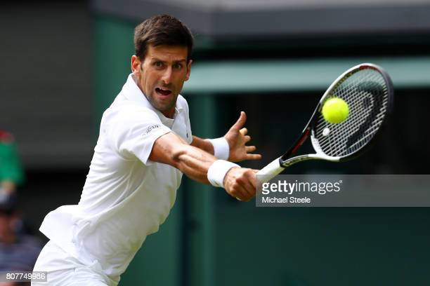 Novak Djokovic of Serbia plays a backhand during the Gentlemen's Singles first round match against Martin Klizan of Slovakia on day two of the...