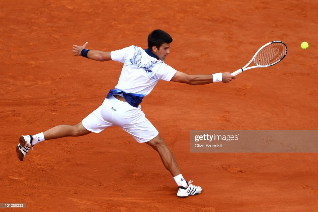 Novak Djokovic of Serbia plays a backhand during the men's singles third round match between Novak Djokovic of Serbia and Victor Hanescu of Romania at the French Open on day seven of the French Open at Roland Garros on May 29, 2010 in Paris, France.