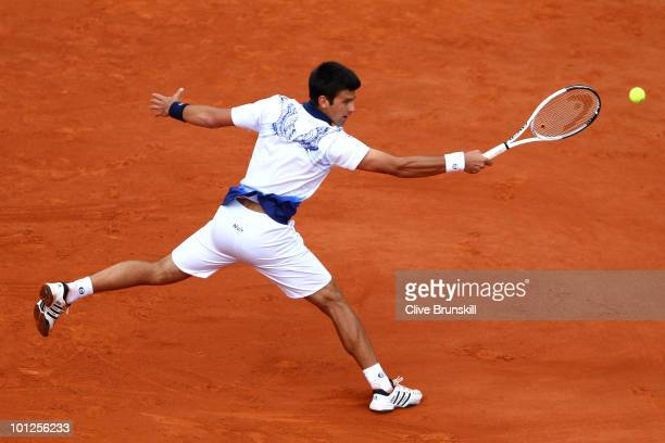 Novak Djokovic of Serbia plays a backhand during the men's singles third round match between Novak Djokovic of Serbia and Victor Hanescu of Romania...