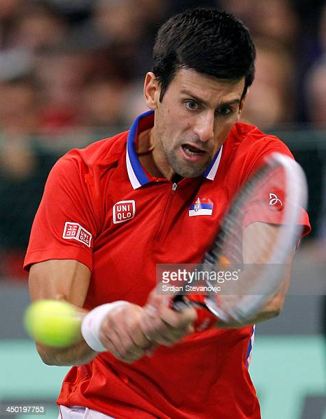 Novak Djokovic of Serbia plays a backhand during the mens singles match between Novak Djokovic of Serbia and Tomas Berdych of Czech Republic on day...