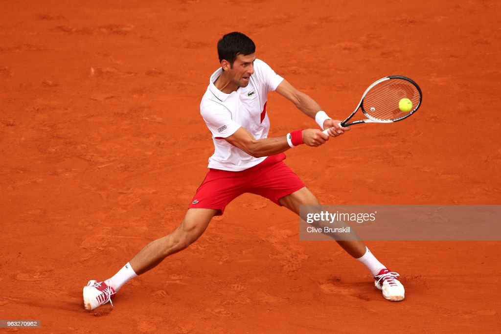 Novak Djokovic of Serbia plays a backhand during the mens singles first round match against Rogerio Dutra Silva of Brazil during day two of the 2018 French Open at Roland Garros on May 28, 2018 in Paris, France.