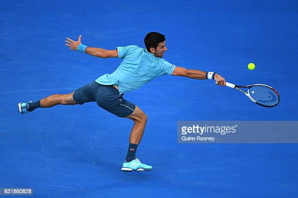 Novak Djokovic of Serbia plays a backhand in his first round match against Fernando Verdasco of Spain on day two of the 2017 Australian Open at...