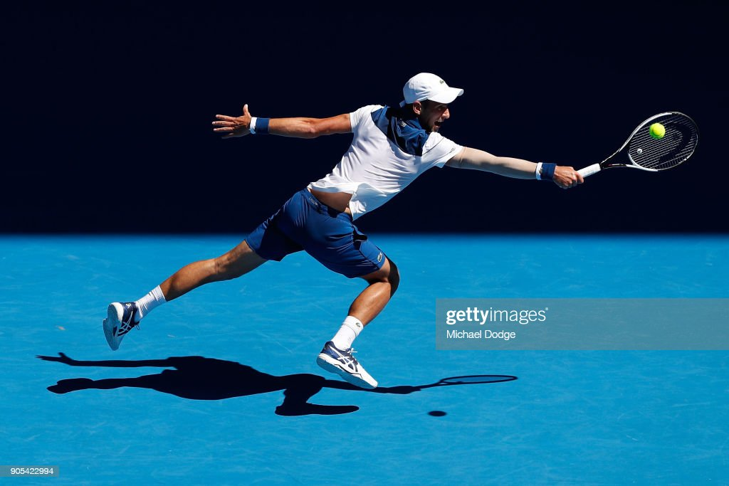 Novak Djokovic of Serbia plays a backhand in his first round match against Donald Young of the United States on day two of the 2018 Australian Open at Melbourne Park on January 16, 2018 in Melbourne, Australia.