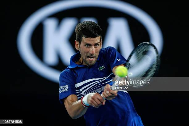 Novak Djokovic of Serbia plays a backhand in his fourth round match against Daniil Medvedev of Russia during day eight of the 2019 Australian Open at...