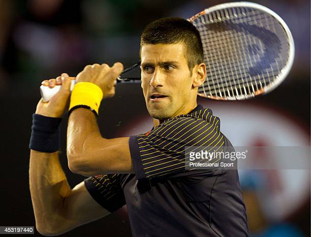 Novak Djokovic of Serbia plays a backhand in his fourth round match against Stanislas Wawrinka of Switzerland during day seven of the 2013 Australian...