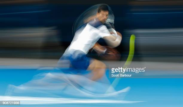 Novak Djokovic of Serbia plays a backhand in his fourth round match against Hyeon Chung of South Korea on day eight of the 2018 Australian Open at...