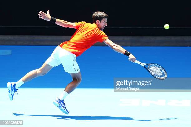Novak Djokovic of Serbia plays a backhand in his match against Andy Murray of Great Britain ahead of the 2019 Australian Open at Melbourne Park on...