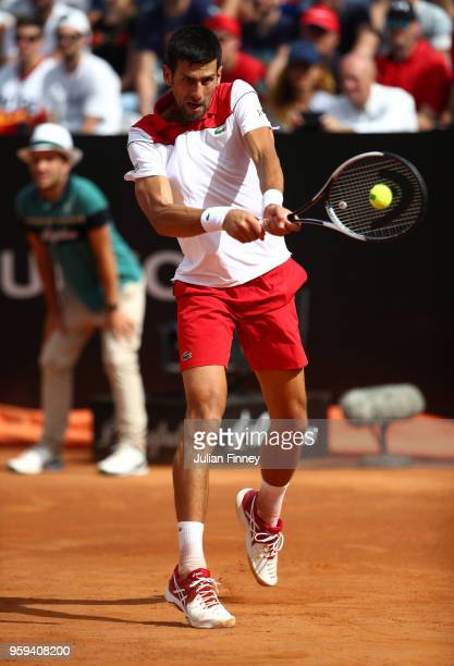 Novak Djokovic of Serbia plays a backhand in his match against Nikoloz Basilashvili of Georgia during day four of the Internazionali BNL d'Italia...