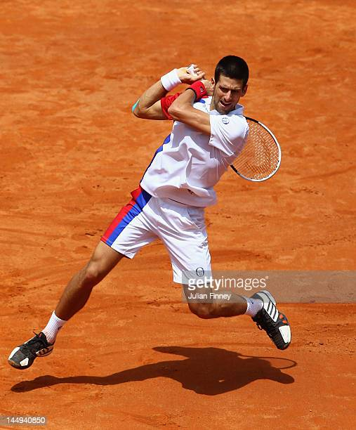 Novak Djokovic of Serbia plays a backhand in his match against Rafael Nadal of Spain in the final during day ten of the Internazionali BNL d'Italia...