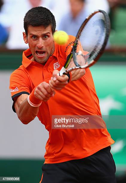 Novak Djokovic of Serbia plays a backhand in his Men's Semi Final match against Andy Murray of Great Britain on day thirteen of the 2015 French Open...
