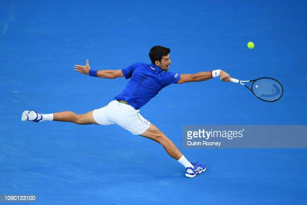 Novak Djokovic of Serbia plays a backhand in his Men's Singles Final match against Rafael Nadal of Spain during day 14 of the 2019 Australian Open at...