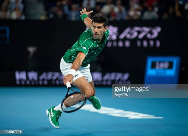 Novak Djokovic of Serbia plays a backhand in his men's singles final match against Dominic Thiem of Austria on day fourteen of the 2020 Australian...