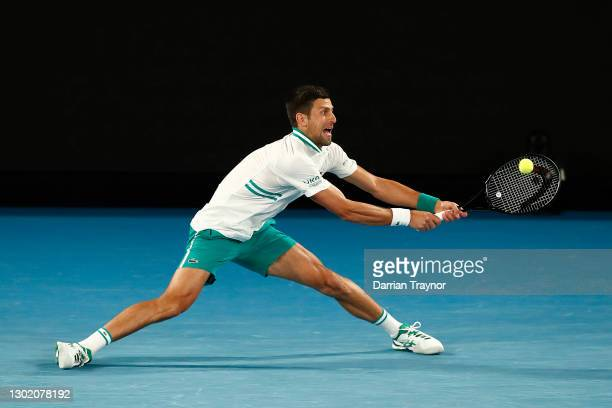 Novak Djokovic of Serbia plays a backhand in his Men's Singles fourth round match against Milos Raonic of Canada during day seven of the 2021...