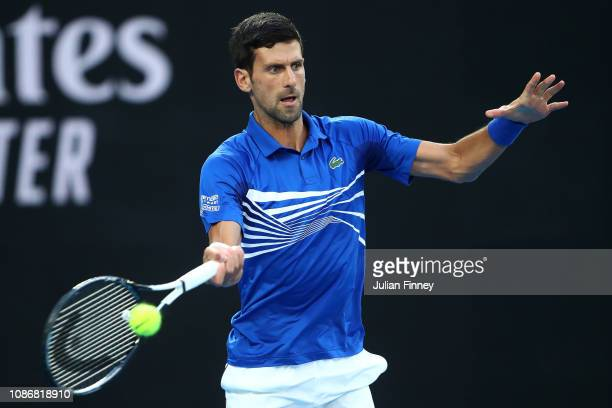 Novak Djokovic of Serbia plays a backhand in his quarter final match against Kei Nishikori of Japan during day 10 of the 2019 Australian Open at...