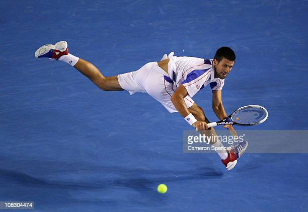 Novak Djokovic of Serbia plays a backhand in his quarterfinal match against Tomas Berdych of the Czech Republic during day nine of the 2011...