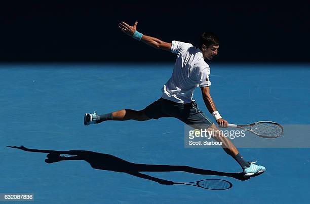 Novak Djokovic of Serbia plays a backhand in his second round match against Denis Istomin of Uzbekistan on day four of the 2017 Australian Open at...