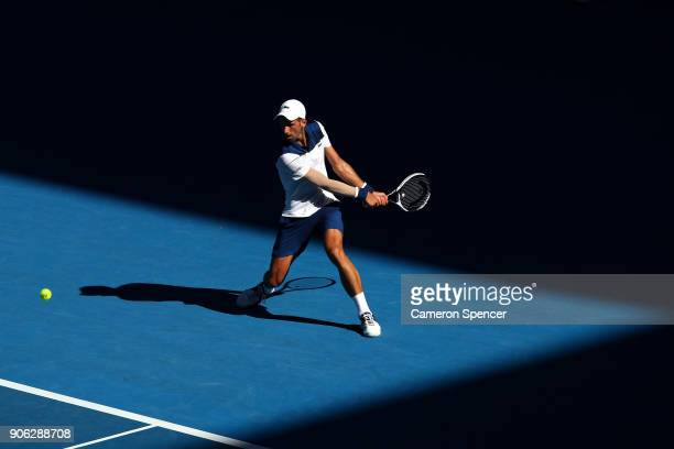 Novak Djokovic of Serbia plays a backhand in his second round match against Gael Monfils of France on day four of the 2018 Australian Open at...