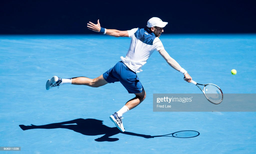Novak Djokovic of Serbia plays a backhand in his second round match against Gael Monfils of France on day four of the 2018 Australian Open at Melbourne Park on January 18, 2018 in Melbourne, Australia.