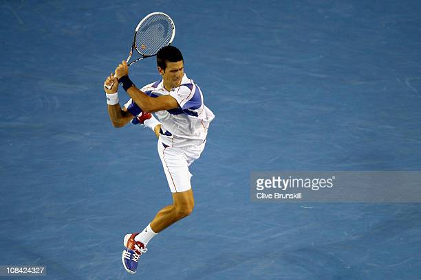 Novak Djokovic of Serbia plays a backhand in his semifinal match against Roger Federer of Switzerland during day eleven of the 2011 Australian Open...