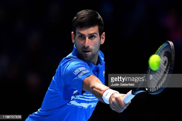 Novak Djokovic of Serbia plays a backhand in his singles match against Matteo Berrettini of Italy during Day One of the Nitto ATP World Tour Finals...