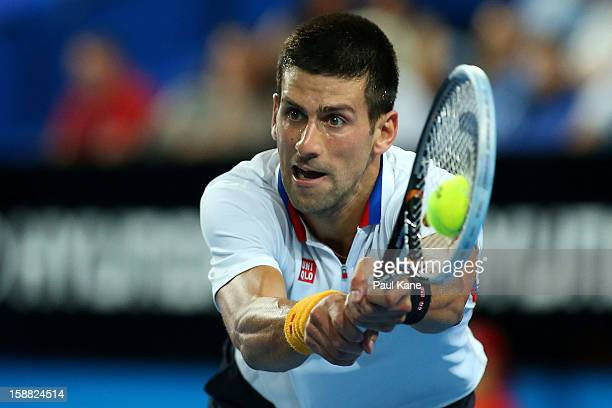 Novak Djokovic of Serbia plays a backhand in his singles match against Andreas Seppi of of Italy during day three of the Hopman Cup at Perth Arena on...