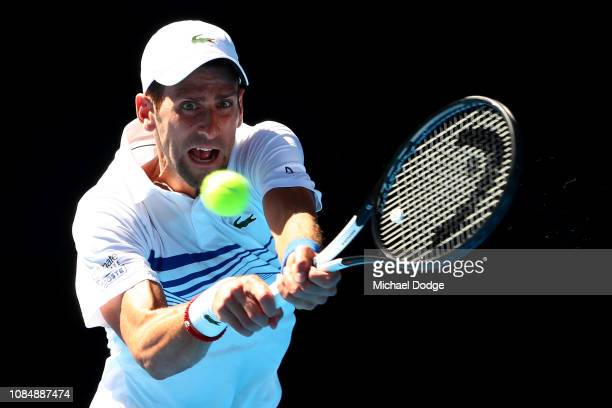 Novak Djokovic of Serbia plays a backhand in his third round match against Denis Shapovalov of Canada during day six of the 2019 Australian Open at...