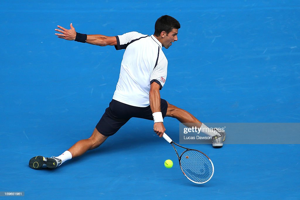 Novak Djokovic of Serbia plays a backhand in his third round match against Radek Stepanek of the Czech Republic during day five of the 2013 Australian Open at Melbourne Park on January 18, 2013 in Melbourne, Australia.
