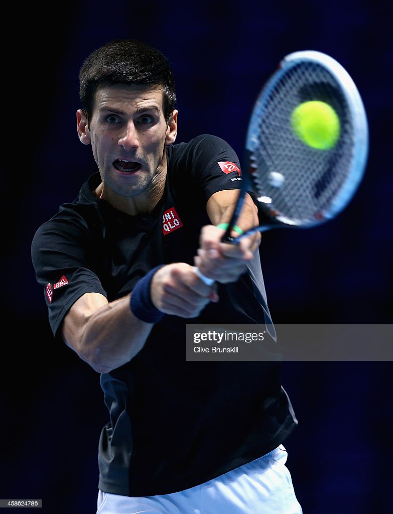 Novak Djokovic of Serbia plays a backhand in practice during the Barclays ATP World Tour Finals tennis previews at the O2 Arena on November 8, 2014 in London, England.