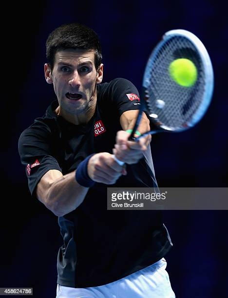 Novak Djokovic of Serbia plays a backhand in practice during the Barclays ATP World Tour Finals tennis previews at the O2 Arena on November 8 2014 in...