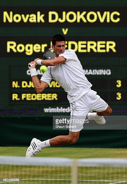 Novak Djokovic of Serbia plays a backhand in the Final Of The Gentlemen's Singles against Roger Federer of Switzerland on day thirteen of the...