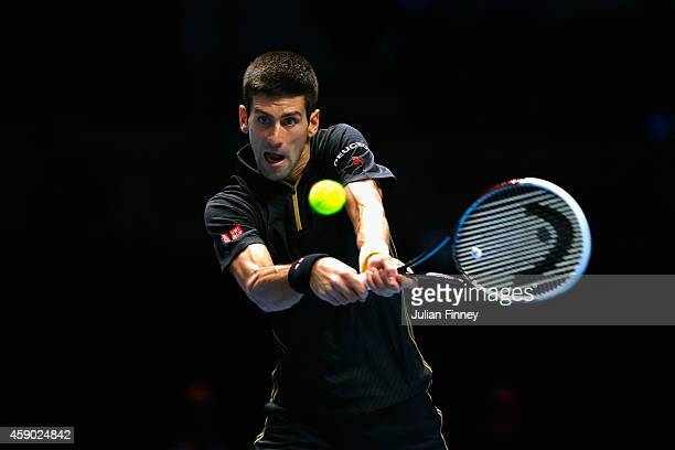 Novak Djokovic of Serbia plays a backhand in the singles semi-final match against Kei Nishikori of Japan on day seven of the Barclays ATP World Tour...