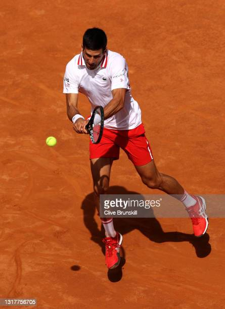 Novak Djokovic of Serbia plays a backhand in their men's singles third round match against Davidovich Fokina of Spain during Day Six of the...